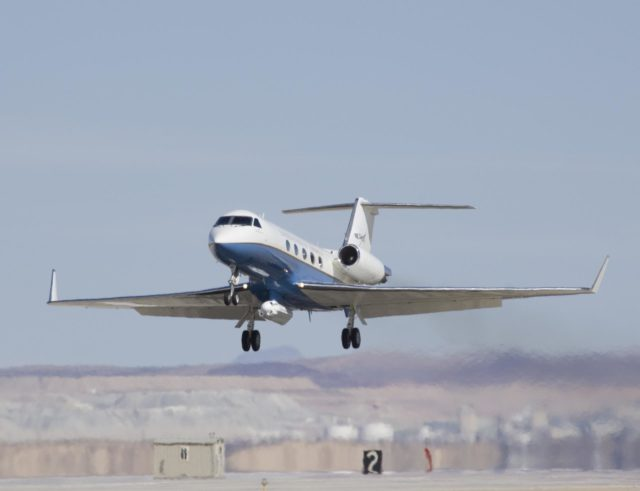 Shimmering heat waves trail behind NASA's Gulfstream-III research aircraft as it departs the Edwards AFB runway on a UAVSAR pod checkout test flight. ED07-0027-68