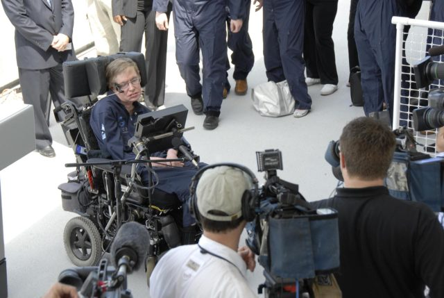 KENNEDY SPACE CENTER, FLA. —  Noted physicist Stephen Hawking greets the media after his arrival at the Kennedy Space Center Shuttle Landing Facility for his first zero-gravity flight. The flight will be aboard a modified Boeing 727 aircraft owned by Zero Gravity Corp., a commercial company licensed to provide the public with weightless flight experiences. Hawking developed amyotrophic lateral sclerosis disease in the 1960s, a type of motor neuron disease which would cost him the loss of almost all neuromuscular control. At the celebration of his 65th birthday on January 8 this year, Hawking announced his plans for a zero-gravity flight to prepare for a sub-orbital space flight in 2009 on Virgin Galactic's space service.  Photo credit: NASA/Kim Shiflett KSC-07pd0948
