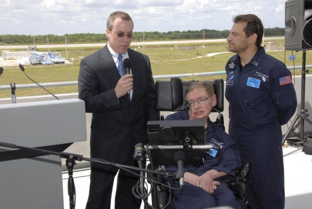 KENNEDY SPACE CENTER, FLA. -- At the Kennedy Space Center Shuttle Landing Facility, Space Florida president Steve Kohler (left) talks to the media about physicist Stephen Hawking's (in the wheelchair) first zero-gravity flight. The flight will be aboard a modified Boeing 727 aircraft owned by Zero Gravity Corp., a commercial company licensed to provide the public with weightless flight experiences.  At right is Peter Diamandis, founder of the Zero Gravity Corp.  Hawking developed amyotrophic lateral sclerosis disease in the 1960s, a type of motor neuron disease which would cost him the loss of almost all neuromuscular control. At the celebration of his 65th birthday on January 8 this year, Hawking announced his plans for a zero-gravity flight to prepare for a sub-orbital space flight in 2009 on Virgin Galactic's space service.  Photo credit: NASA/Kim Shiflett KSC-07pd0950