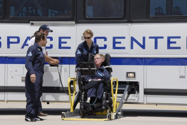 KENNEDY SPACE CENTER, FLA. -- At the Kennedy Space Center Shuttle Landing Facility, noted physicist Stephen Hawking, in the wheelchair, arrives at the runway for his first zero-gravity flight. The flight will be aboard a modified Boeing 727 aircraft owned by Zero Gravity Corp., a commercial company licensed to provide the public with weightless flight experiences.  At left is Peter Diamandis, founder of the Zero Gravity Corp. Behind Hawking is Nicola O'Brien, a nurse practitioner who is Hawking's aide.   Hawking developed amyotrophic lateral sclerosis disease in the 1960s, a type of motor neuron disease which would cost him the loss of almost all neuromuscular control. At the celebration of his 65th birthday on January 8 this year, Hawking announced his plans for a zero-gravity flight to prepare for a sub-orbital space flight in 2009 on Virgin Galactic's space service.  Photo credit: NASA/Kim Shiflett KSC-07pd0952