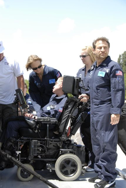 KENNEDY SPACE CENTER, FLA. -- At the Kennedy Space Center Shuttle Landing Facility, noted physicist Stephen Hawking, in the wheelchair, is ready to get onboard a modified Boeing 727 aircraft owned by Zero Gravity Corp. for his first zero-gravity flight.  Zero Gravity Corp. is a commercial company licensed to provide the public with weightless flight experiences.  At right is Peter Diamandis, founder of the Zero Gravity Corp.  Behind Hawking is Nicola O'Brien, a nurse practitioner who is Hawking's aide.  Hawking developed amyotrophic lateral sclerosis disease in the 1960s, a type of motor neuron disease which would cost him the loss of almost all neuromuscular control. At the celebration of his 65th birthday on January 8 this year, Hawking announced his plans for a zero-gravity flight to prepare for a sub-orbital space flight in 2009 on Virgin Galactic's space service.  Photo credit: NASA/Kim Shiflett KSC-07pd0955