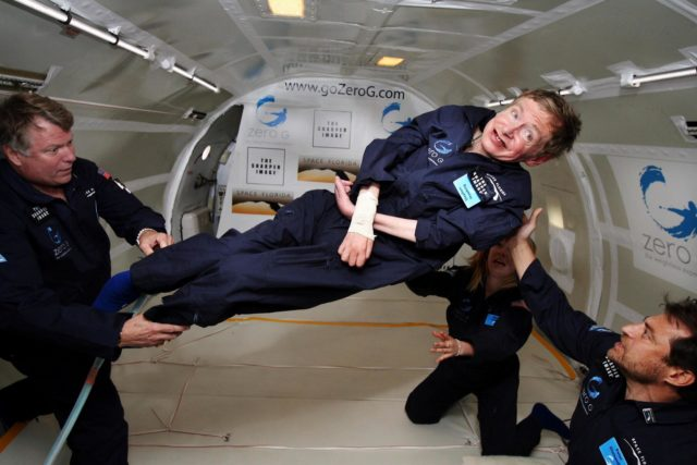 KENNEDY SPACE CENTER, FLA. -- Noted physicist Stephen Hawking (center) enjoys zero gravity during a flight aboard  a modified Boeing 727 aircraft owned by Zero Gravity Corp. (Zero G).  Hawking, who suffers from amyotrophic lateral sclerosis (also known as Lou Gehrig's disease) is being rotated in air by (right) Peter Diamandis, founder of the Zero G Corp., and (left) Byron Lichtenberg, former shuttle payload specialist and now president of Zero G.  Kneeling below Hawking is Nicola O'Brien, a nurse practitioner who is Hawking's aide.  At the celebration of his 65th birthday on January 8 this year, Hawking announced his plans for a zero-gravity flight to prepare for a sub-orbital space flight in 2009 on Virgin Galactic's space service.  Photo credit: Jim Campbell, Aero-News Network KSC-07pd0958