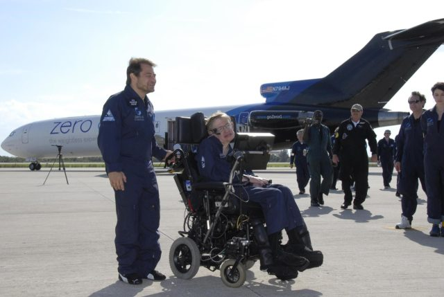 KENNEDY SPACE CENTER, FLA. -- Peter Diamandis (left), founder of the Zero Gravity Corp., and noted physicist Stephen Hawking move away from Zero G's modified Boeing 727 on the runway at the Kennedy Space Center's Shuttle Landing Facility.  Hawking enjoyed his first zero gravity flight provided by Zero G.  At the celebration of his 65th birthday on January 8 this year, Hawking announced his plans for a zero-gravity flight to prepare for a sub-orbital space flight in 2009 on Virgin Galactic's space service.  Photo credit: NASA/Kim Shiflett KSC-07pd0964