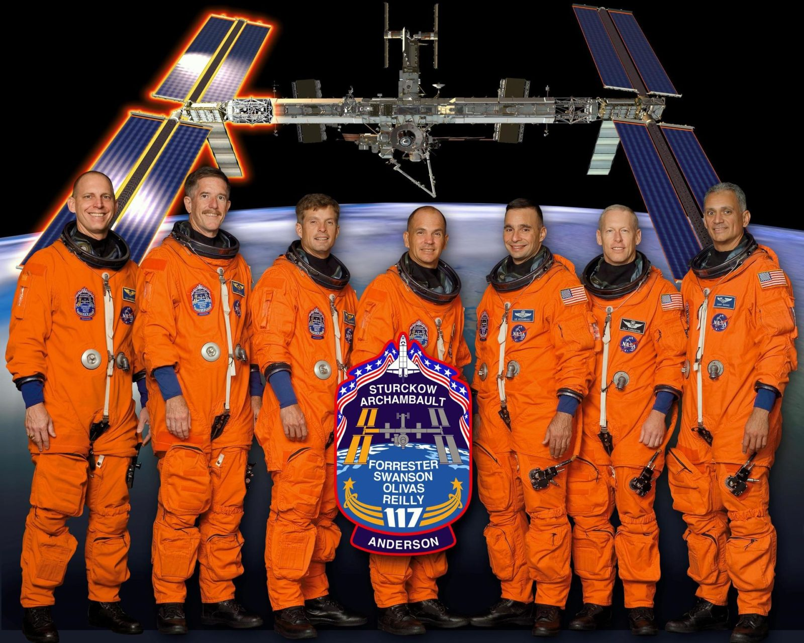 KENNEDY SPACE CENTER, FLA. -- STS117-S-002 (May 2007) --- These seven astronauts take a break from training to pose for the STS-117 crew portrait. Scheduled to launch aboard the Space Shuttle Atlantis are (from the left) astronauts Clayton C. Anderson, James F. Reilly II, Steven R. Swanson, mission specialists; Frederick W. (Rick) Sturckow, commander; Lee J. Archambault, pilot; Patrick G. Forrester and John D. (Danny) Olivas, mission specialists. Anderson will join Expedition 15 in progress to serve as a flight engineer aboard the International Space Station. The crewmembers are attired in training versions of their shuttle launch and entry suits. KSC-07pd1262