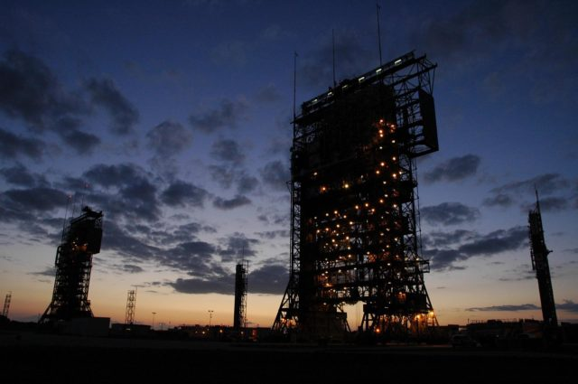KENNEDY SPACE CENTER, FLA. -- The mobile service towers on Launch Pads 17-A (left) and 17-B (right) are silhouetted against the pre-dawn sky at Cape Canaveral Air Force Station. In the background are the launch gantries.  Pad 17-B is the site for the launch of the Dawn spacecraft on June 30.  Dawn's mission is to explore two of the asteroid belt's most intriguing and dissimilar occupants: asteroid Vesta and the dwarf planet Ceres.   Photo credit: NASA/Amanda Diller KSC-07pd1307