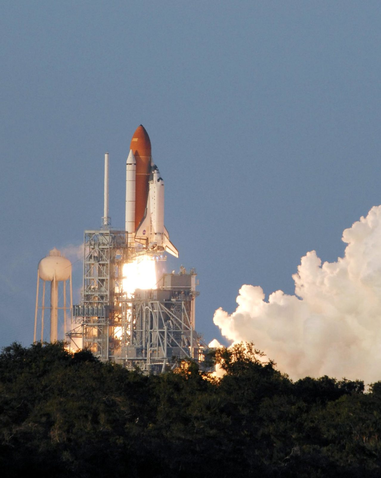 """STS117-S-010 (8 June 2007) --- The Space Shuttle Atlantis and its seven-member STS-117 crew head toward Earth-orbit and a scheduled link-up with the International Space Station. Liftoff from Kennedy Space Center's launch pad 39A occurred at 7:38 p.m. (EDT) on June 8, 2007. Onboard are astronauts Rick Sturckow, commander; Lee Archambault, pilot; Jim Reilly, Patrick Forrester, John """"Danny"""" Olivas, Steven Swanson and Clayton Anderson, all mission specialists. Anderson will join Expedition 15 in progress to serve as a flight engineer aboard the station. Atlantis will dock with the orbital outpost on Sunday, June 10, to begin a joint mission that will increase the complex's power generation capability. Using the shuttle and station robotic arms and conducting three scheduled spacewalks, the astronauts will install another set of giant solar array wings on the station and retract another array, preparing it for a future move. STS117-S-010"""
