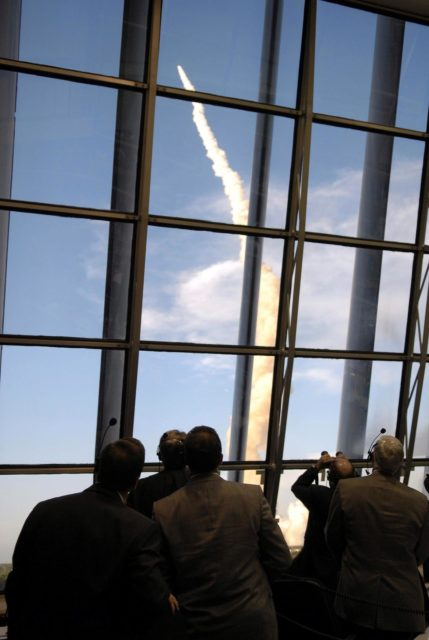 "STS117-S-014 (8 June 2007) --- Through the large windows in the Launch Control Center, NASA officials watch the launch of Space Shuttle Atlantis on mission STS-117. Atlantis and its seven-member crew head toward Earth-orbit and a scheduled link-up with the International Space Station. Liftoff from Kennedy Space Center's launch pad 39A occurred at 7:38 p.m. (EDT) on June 8, 2007. Onboard are astronauts Rick Sturckow, commander; Lee Archambault, pilot; Jim Reilly, Patrick Forrester, John ""Danny"" Olivas, Steven Swanson and Clayton Anderson, all mission specialists. Anderson will join Expedition 15 in progress to serve as a flight engineer aboard the station. Atlantis will dock with the orbital outpost on Sunday, June 10, to begin a joint mission that will increase the complex's power generation capability. Using the shuttle and station robotic arms and conducting three scheduled spacewalks, the astronauts will install another set of giant solar array wings on the station and retract another array, preparing it for a future move. STS117-S-014"