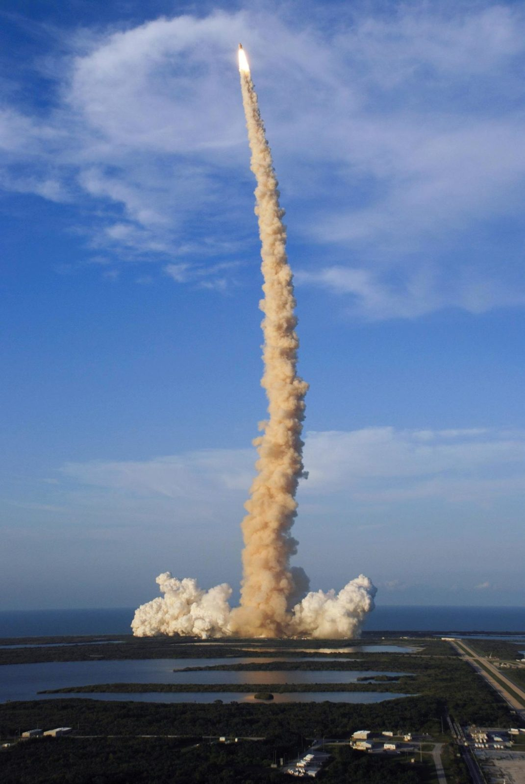 """STS117-S-017 (8 June 2007) --- The Space Shuttle Atlantis and its seven-member STS-117 crew head toward Earth-orbit and a scheduled link-up with the International Space Station. Liftoff from Kennedy Space Center's launch pad 39A occurred at 7:38 p.m. (EDT) on June 8, 2007. Onboard are astronauts Rick Sturckow, commander; Lee Archambault, pilot; Jim Reilly, Patrick Forrester, John """"Danny"""" Olivas, Steven Swanson and Clayton Anderson, all mission specialists. Anderson will join Expedition 15 in progress to serve as a flight engineer aboard the station. Atlantis will dock with the orbital outpost on Sunday, June 10, to begin a joint mission that will increase the complex's power generation capability. Using the shuttle and station robotic arms and conducting three scheduled spacewalks, the astronauts will install another set of giant solar array wings on the station and retract another array, preparing it for a future move. STS117-S-017"""