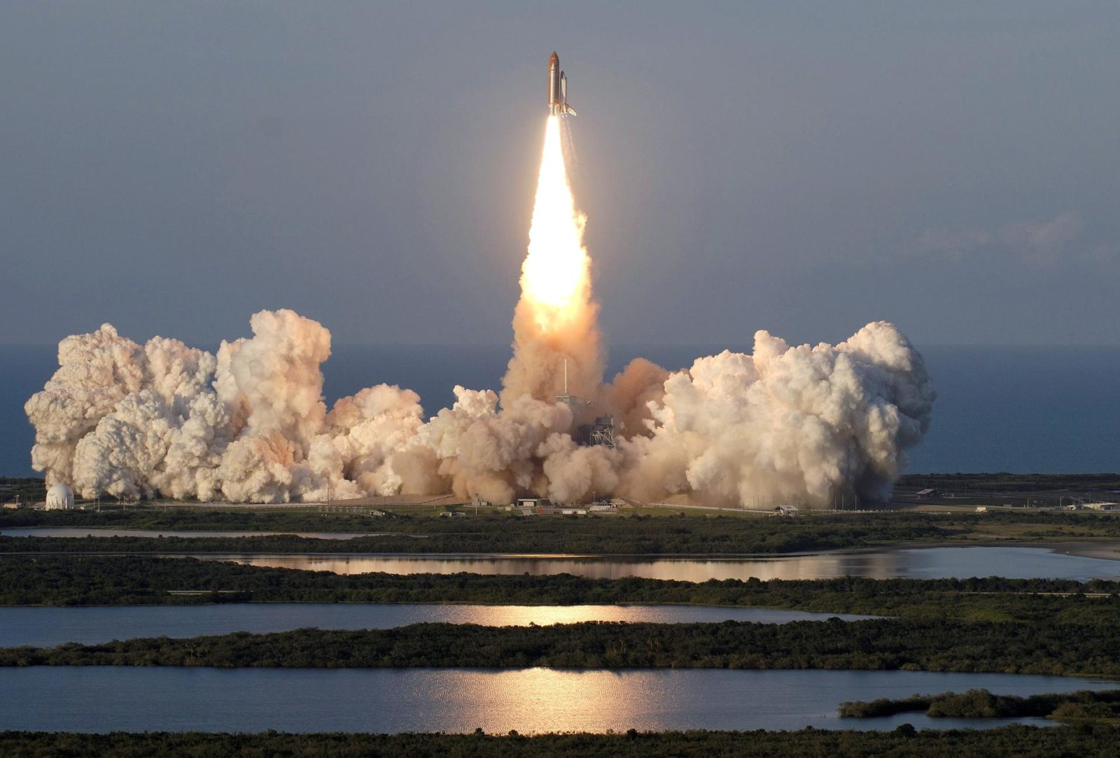 """STS117-S-019 (8 June 2007) --- The Space Shuttle Atlantis and its seven-member STS-117 crew head toward Earth-orbit and a scheduled link-up with the International Space Station. Liftoff from Kennedy Space Center's launch pad 39A occurred at 7:38 p.m. (EDT) on June 8, 2007. Onboard are astronauts Rick Sturckow, commander; Lee Archambault, pilot; Jim Reilly, Patrick Forrester, John """"Danny"""" Olivas, Steven Swanson and Clayton Anderson, all mission specialists. Anderson will join Expedition 15 in progress to serve as a flight engineer aboard the station. Atlantis will dock with the orbital outpost on Sunday, June 10, to begin a joint mission that will increase the complex's power generation capability. Using the shuttle and station robotic arms and conducting three scheduled spacewalks, the astronauts will install another set of giant solar array wings on the station and retract another array, preparing it for a future move. STS117-S-019"""