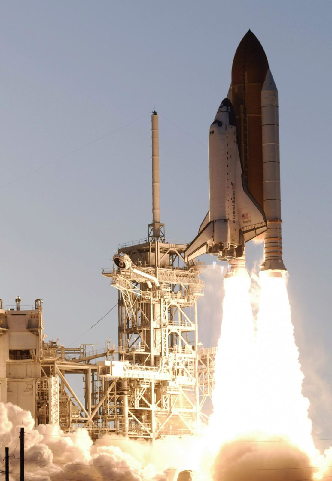 """STS117-S-025 (8 June 2007) --- The Space Shuttle Atlantis and its seven-member STS-117 crew head toward Earth-orbit and a scheduled link-up with the International Space Station. Liftoff from Kennedy Space Center's launch pad 39A occurred at 7:38 p.m. (EDT) on June 8, 2007. Onboard are astronauts Rick Sturckow, commander; Lee Archambault, pilot; Jim Reilly, Patrick Forrester, John """"Danny"""" Olivas, Steven Swanson and Clayton Anderson, all mission specialists. Anderson will join Expedition 15 in progress to serve as a flight engineer aboard the station. Atlantis will dock with the orbital outpost on Sunday, June 10, to begin a joint mission that will increase the complex's power generation capability. Using the shuttle and station robotic arms and conducting three scheduled spacewalks, the astronauts will install another set of giant solar array wings on the station and retract another array, preparing it for a future move. STS117-S-025"""