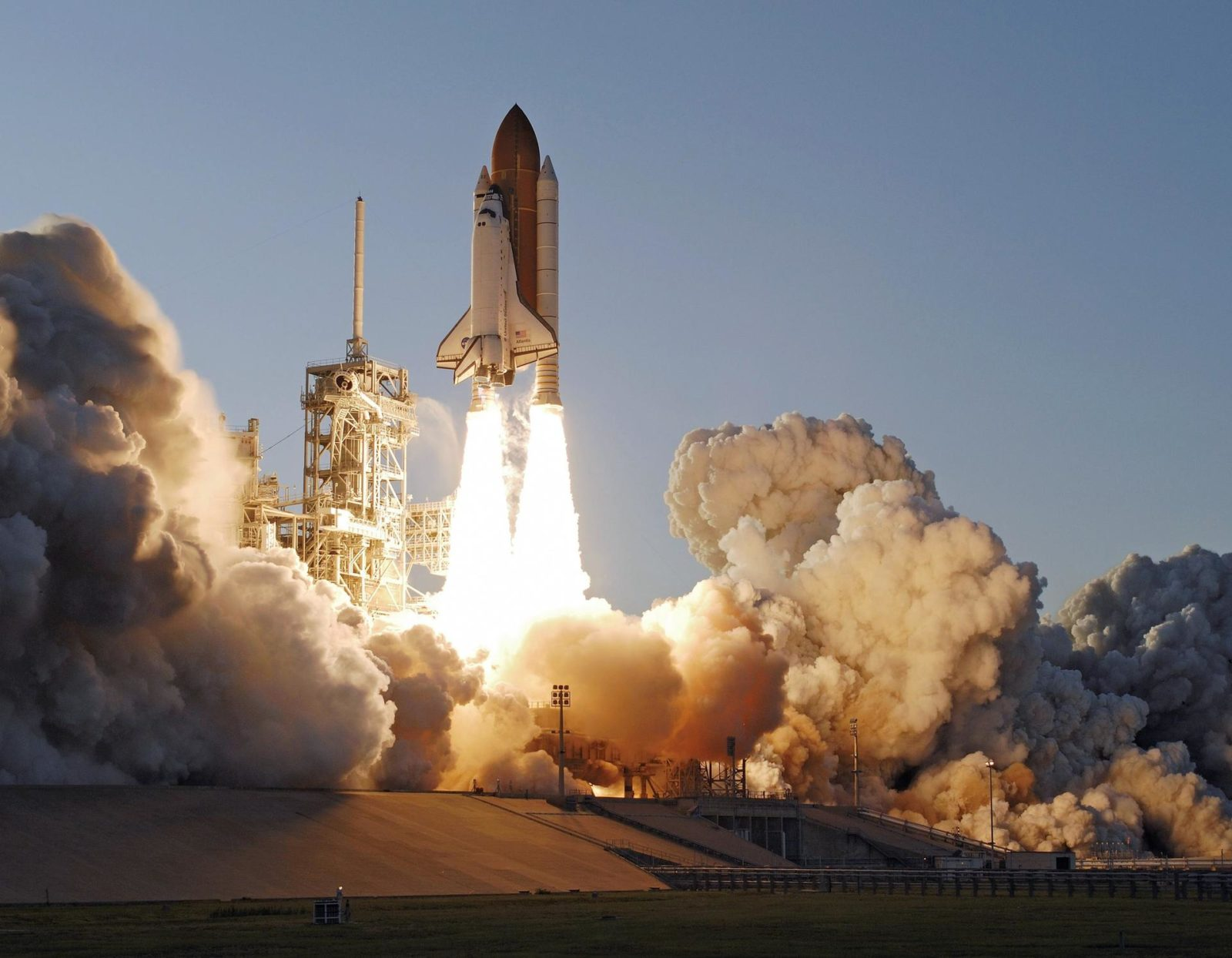 """STS117-S-027 (8 June 2007) --- The Space Shuttle Atlantis and its seven-member STS-117 crew head toward Earth-orbit and a scheduled link-up with the International Space Station. Liftoff from Kennedy Space Center's launch pad 39A occurred at 7:38 p.m. (EDT) on June 8, 2007. Onboard are astronauts Rick Sturckow, commander; Lee Archambault, pilot; Jim Reilly, Patrick Forrester, John """"Danny"""" Olivas, Steven Swanson and Clayton Anderson, all mission specialists. Anderson will join Expedition 15 in progress to serve as a flight engineer aboard the station. Atlantis will dock with the orbital outpost on Sunday, June 10, to begin a joint mission that will increase the complex's power generation capability. Using the shuttle and station robotic arms and conducting three scheduled spacewalks, the astronauts will install another set of giant solar array wings on the station and retract another array, preparing it for a future move. STS117-S-027"""