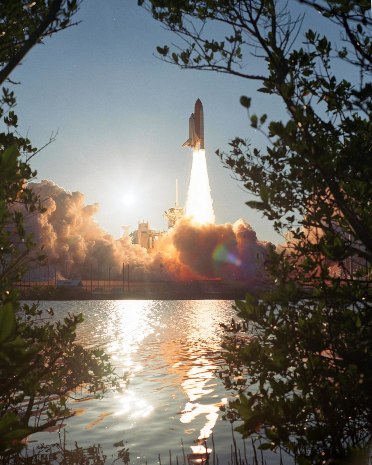 """STS117-S-034 (8 June 2007) --- The Space Shuttle Atlantis and its seven-member STS-117 crew head toward Earth-orbit and a scheduled link-up with the International Space Station. Liftoff from Kennedy Space Center's launch pad 39A occurred at 7:38 p.m. (EDT) on June 8, 2007. Onboard are astronauts Rick Sturckow, commander; Lee Archambault, pilot; Jim Reilly, Patrick Forrester, John """"Danny"""" Olivas, Steven Swanson and Clayton Anderson, all mission specialists. Anderson will join Expedition 15 in progress to serve as a flight engineer aboard the station. Atlantis will dock with the orbital outpost on Sunday, June 10, to begin a joint mission that will increase the complex's power generation capability. Using the shuttle and station robotic arms and conducting three scheduled spacewalks, the astronauts will install another set of giant solar array wings on the station and retract another array, preparing it for a future move. STS117-S-034"""