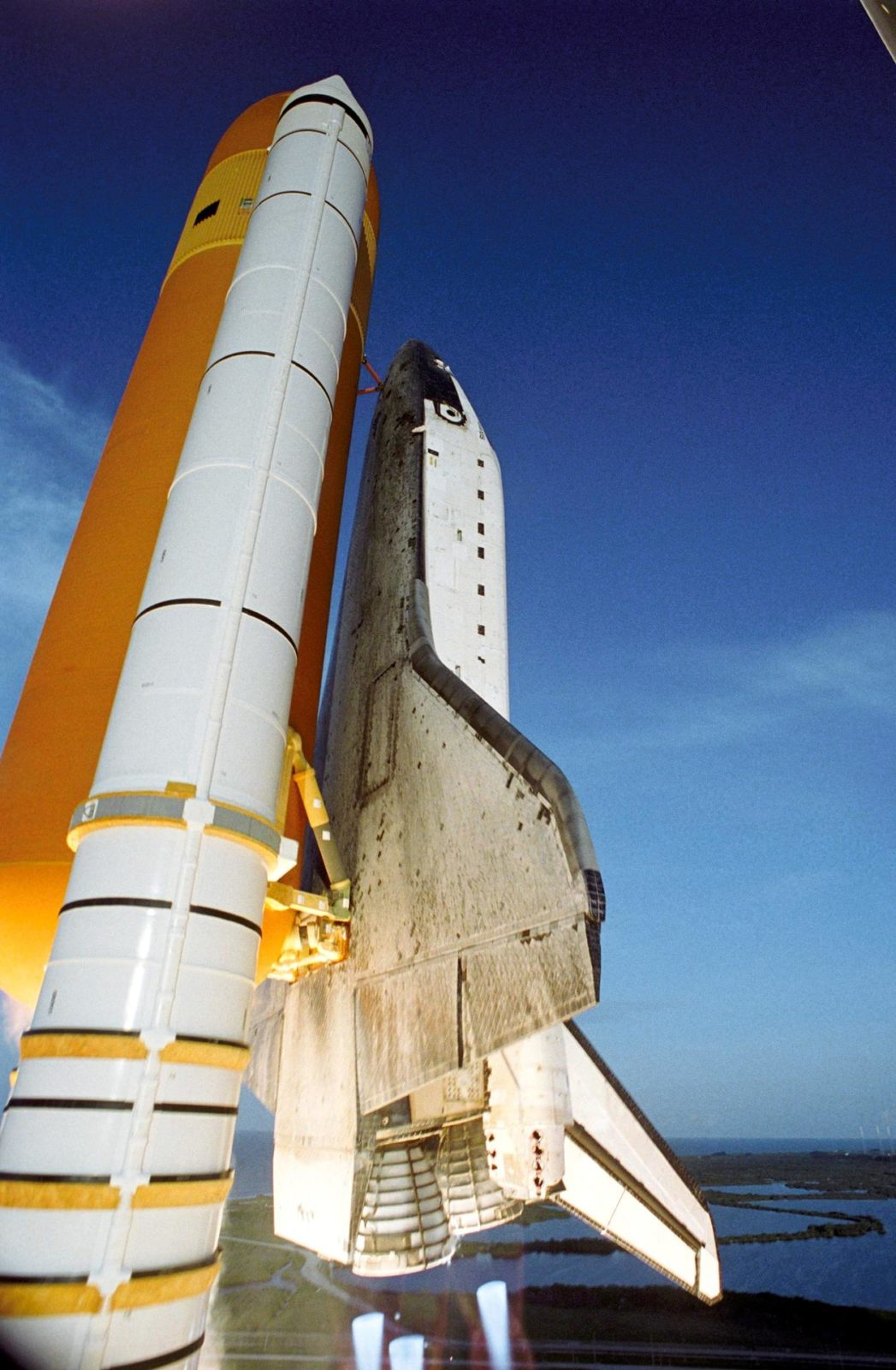 """STS117-S-038 (8 June 2007) --- The Space Shuttle Atlantis and its seven-member STS-117 crew head toward Earth-orbit and a scheduled link-up with the International Space Station. Liftoff from Kennedy Space Center's launch pad 39A occurred at 7:38 p.m. (EDT) on June 8, 2007. Onboard are astronauts Rick Sturckow, commander; Lee Archambault, pilot; Jim Reilly, Patrick Forrester, John """"Danny"""" Olivas, Steven Swanson and Clayton Anderson, all mission specialists. Anderson will join Expedition 15 in progress to serve as a flight engineer aboard the station. Atlantis will dock with the orbital outpost on Sunday, June 10, to begin a joint mission that will increase the complex's power generation capability. Using the shuttle and station robotic arms and conducting three scheduled spacewalks, the astronauts will install another set of giant solar array wings on the station and retract another array, preparing it for a future move. STS117-S-038"""