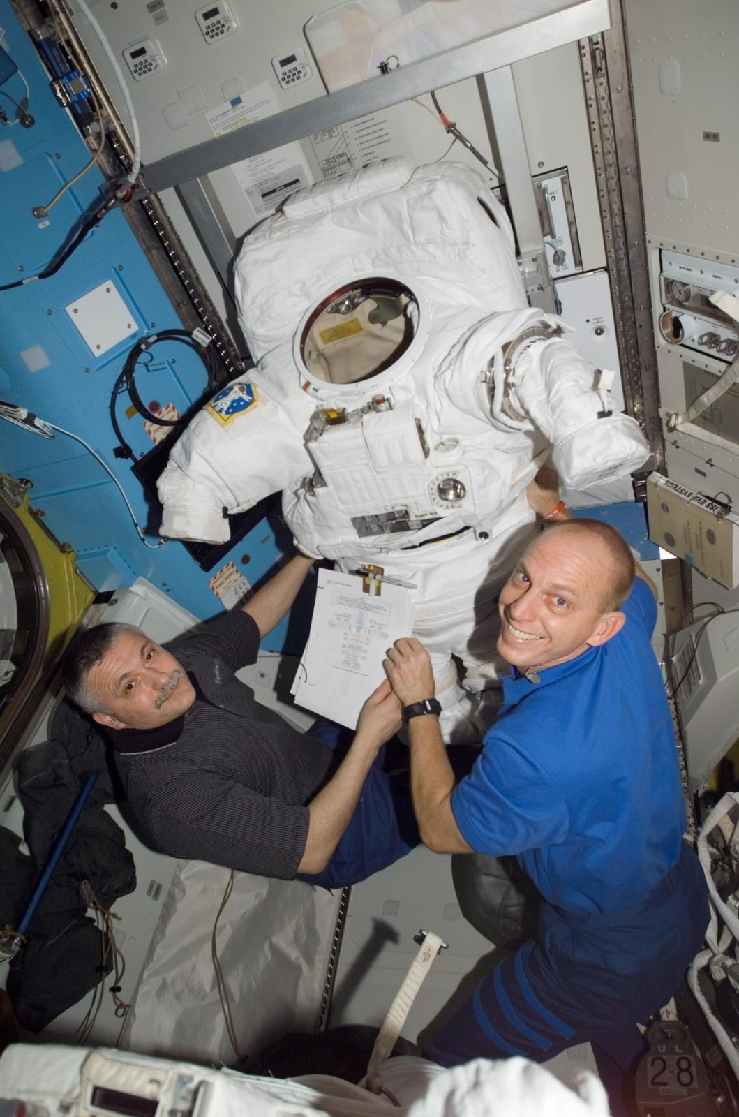 View of Yurchikhin and Anderson posing for a photo in the A/L during Expedition 15