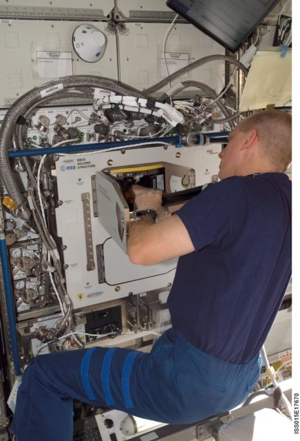 View of Anderson working on the EMCS in the US Lab during Expedition 15