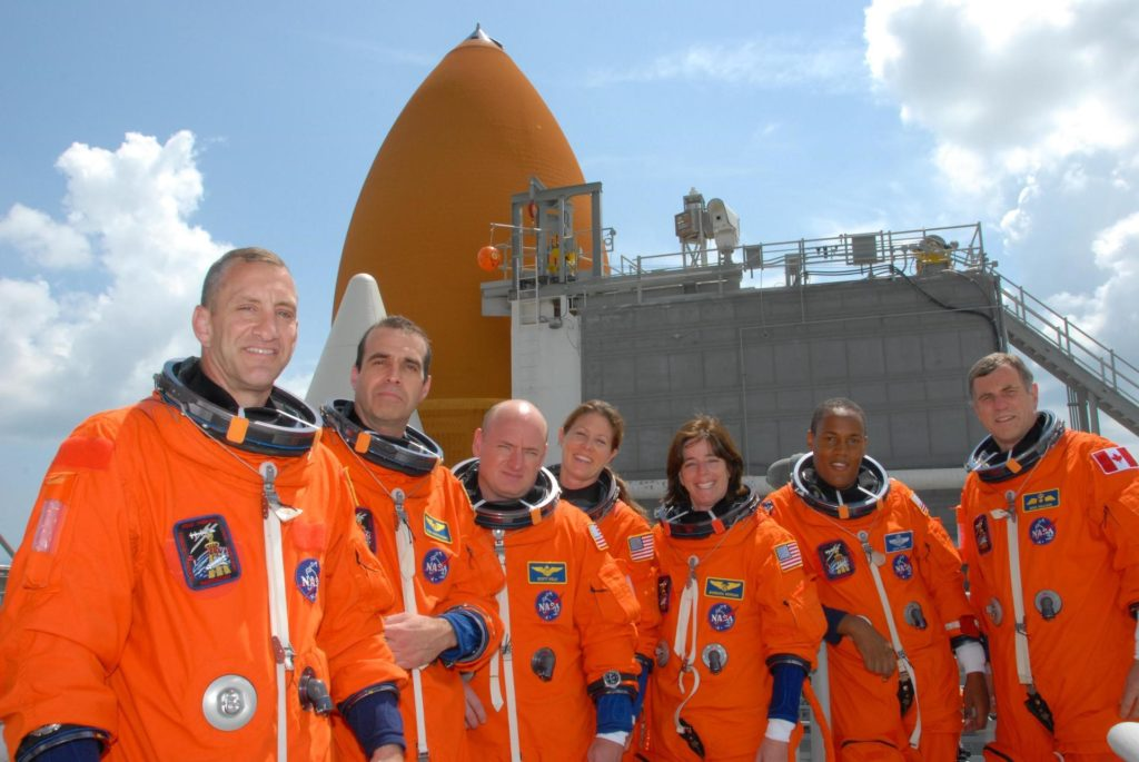 KENNEDY SPACE CENTER, Fla.  --   On top of the fixed service structure of Launch Pad 39A, The STS-118 crew poses for a photo after conclusion of the terminal countdown demonstration test.  From left are Pilot Charlie Hobaugh, Mission Specialist Rick Mastracchio, Commander Scott Kelly, and Mission Specialists Tracy Caldwell, Barbara R. Morgan, Alvin Drew and Dave Williams.  Morgan, who is making her first space flight, joined NASA's Teacher in Space program in 1985 and was selected as an astronaut in 1998.  Williams represents the Canadian Space Agency. The STS-118 mission on Space Shuttle Endeavour is the 22nd flight to the International Space Station and will carry a payload including the S5 truss, a SPACEHAB module and external stowage platform 3. STS-118 is targeted for launch on Aug. 7.  Photo credit:  NASA/George Shelton KSC-07pd2004