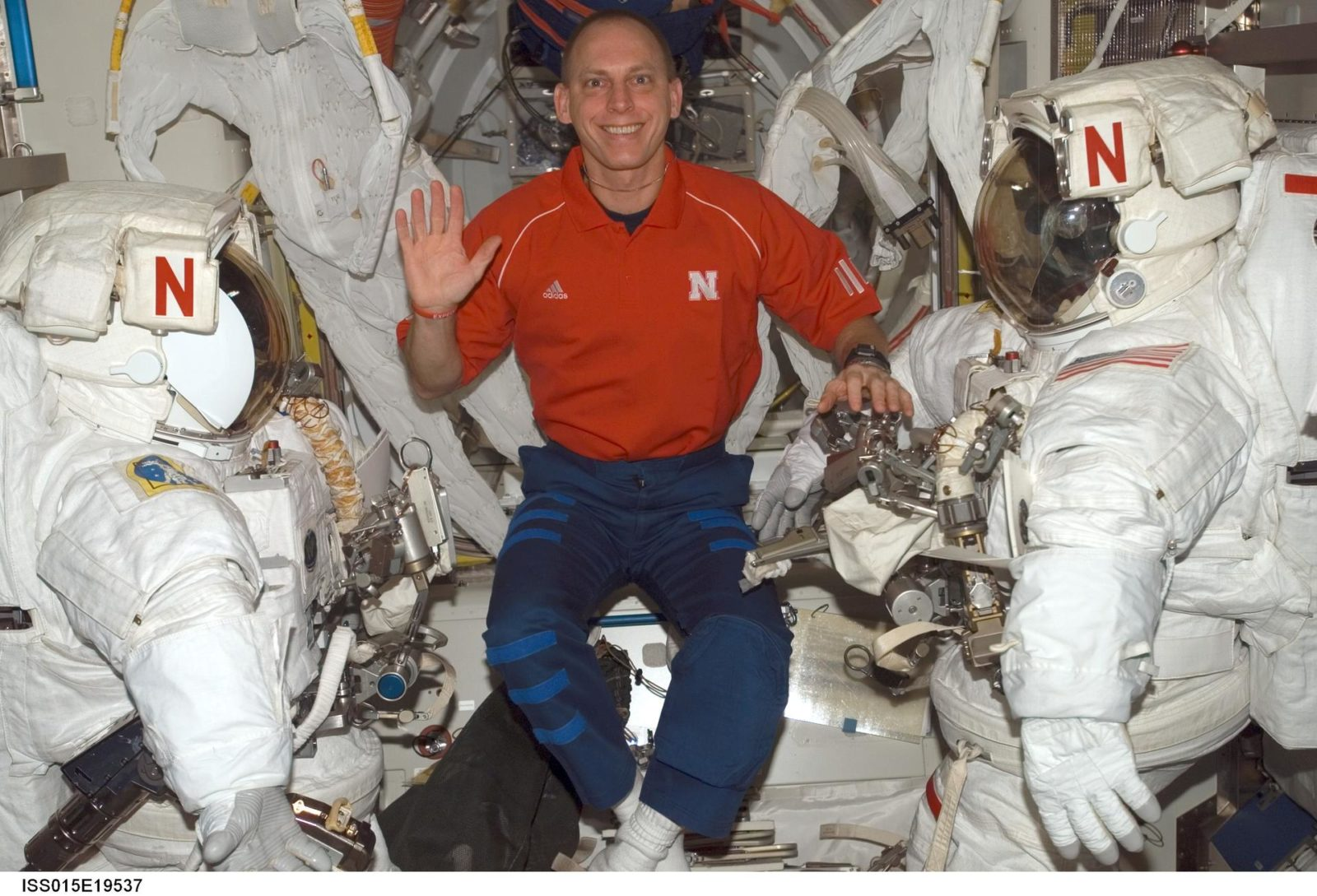 View of Anderson posing for photo in the A/L during Expedition 15