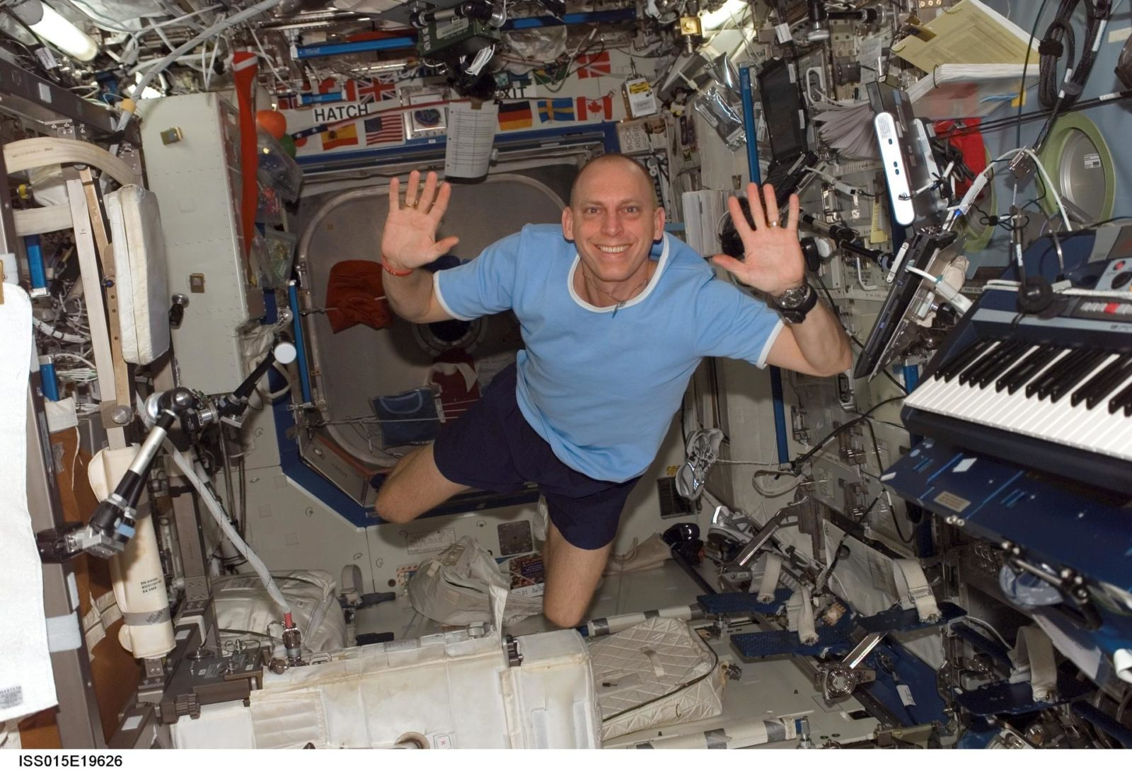 View of Anderson posing for a photo in the US Lab during Expedition 15