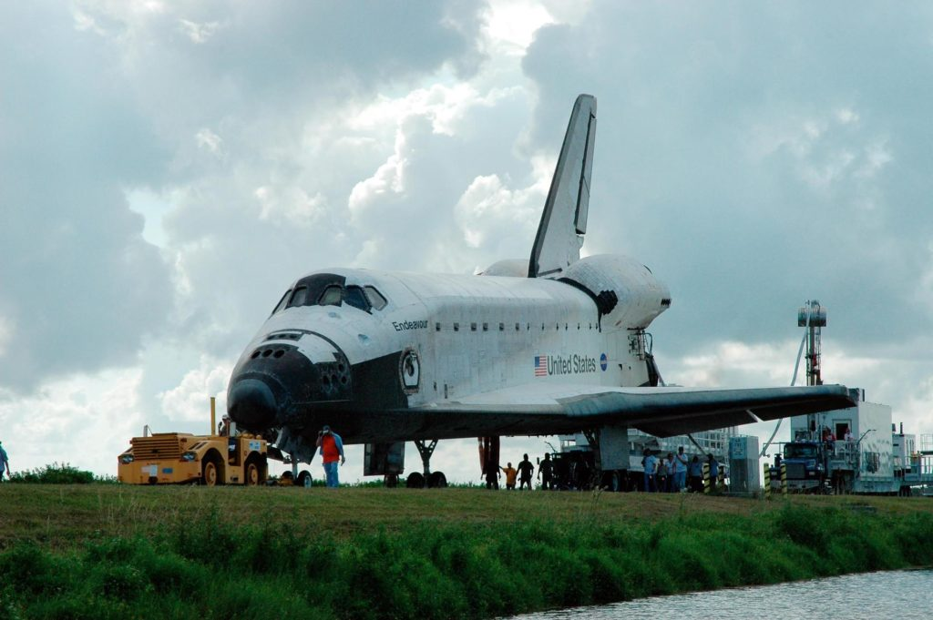 KENNEDY SPACE CENTER, FLA. --   On the Shuttle Landing Facility at NASA's Kennedy Space Center, the orbiter Endeavour is ready to be towed to the Orbiter Processing Facility, known as the OPF. Endeavour returned to Earth Aug. 21 from mission STS-118, landing at Kennedy at 12:32 p.m. EDT. In the OPF bay 2, Endeavour will incur thermal protection system inspections and numerous other post-flight inspections before processing starts for its next voyage into space.  Endeavour will next fly on mission STS-123 targeted for Feb. 14, 2008.  Photo credit: NASA/Jack Pfaller KSC-07pd2360