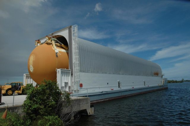 KENNEDY SPACE CENTER, FLA. --   External tank No. 125 is moved out of the Pegasus barge at the Launch Complex 39 Area turn basin.  After offloading, the tank will be transported to the Vehicle Assembly Building. The tank arrived at Kennedy on the Pegasus barge from the Michoud Assembly Facility near New Orleans. The external tank will be used on space shuttle Atlantis for mission STS-122 targeted for launch on Dec. 6.  Photo credit: NASA/Troy Cryder KSC-07pd2464
