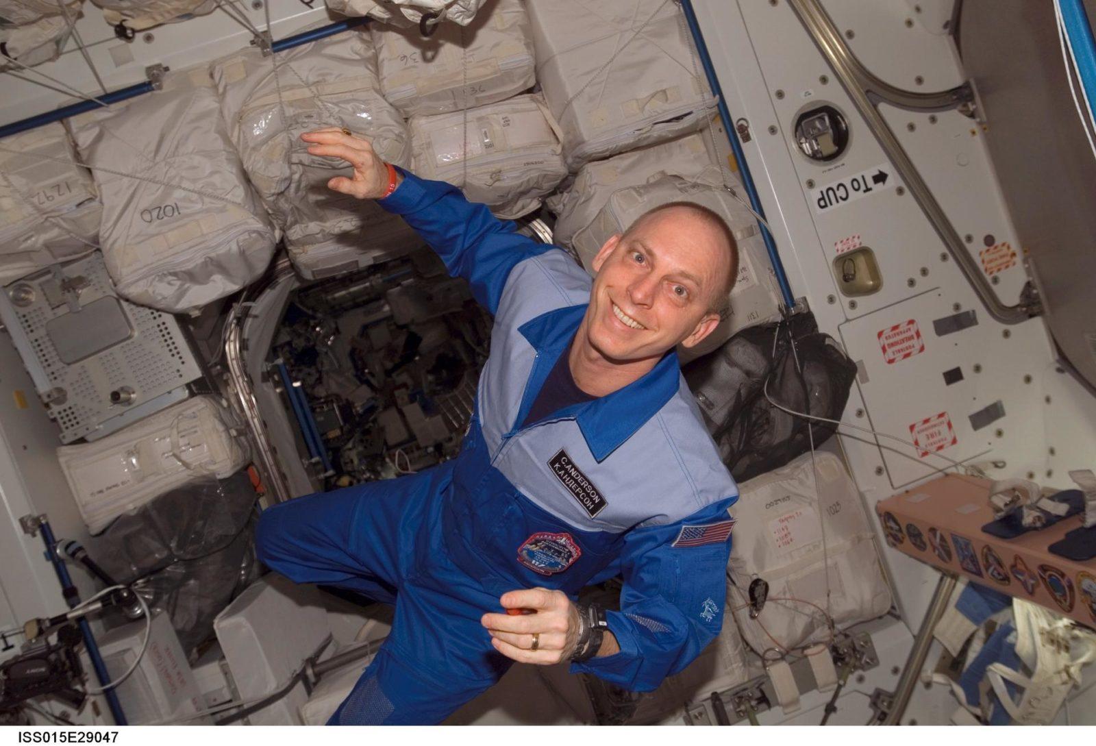 View of Anderson posing for a photo in the Node 1 during Expedition 15