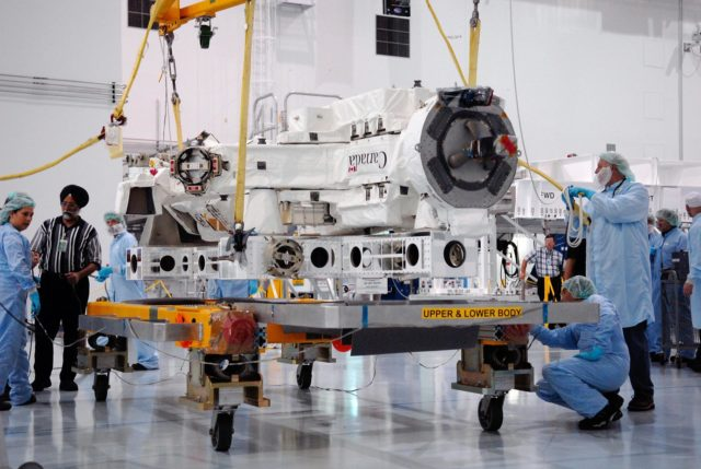 KENNEDY SPACE CENTER, FLA. -- In the Space Station Processing Facility at NASA's Kennedy Space Center, technicians prepare the Special Purpose Dexterous Manipulator, known as Dextre, for its move onto a pallet. Processing of the payload is under way for its mission to the International Space Station. Dextre will work with the mobile base and Canadarm2 on the station to perform critical construction and maintenance tasks. Dextre is part of the payload scheduled on mission STS-123, targeted to launch Feb. 14, 2008.  Photo credit: NASA/Kim Shiflett KSC-07pd2561