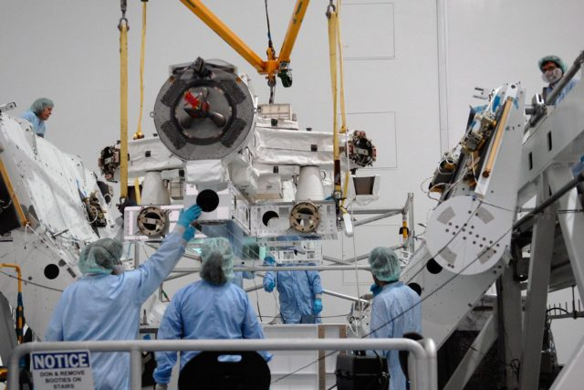KENNEDY SPACE CENTER, FLA. -- In the Space Station Processing Facility at NASA's Kennedy Space Center, technicians monitor the Special Purpose Dexterous Manipulator, known as Dextre, as a crane moves it into position on a pallet.  Processing of the payload is under way for its mission to the International Space Station. Dextre will work with the mobile base and Canadarm2 on the station to perform critical construction and maintenance tasks. Dextre is part of the payload scheduled on mission STS-123, targeted to launch Feb. 14, 2008.  Photo credit: NASA/Kim Shiflett KSC-07pd2567