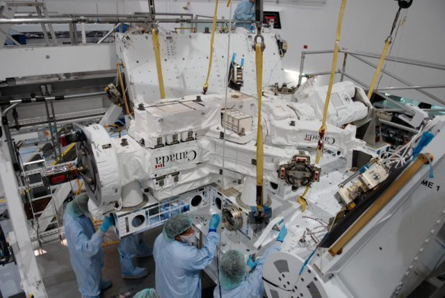 KENNEDY SPACE CENTER, FLA. -- In the Space Station Processing Facility at NASA's Kennedy Space Center, technicians adjust the Special Purpose Dexterous Manipulator, known as Dextre, into position on a pallet.  Processing of the payload is under way for its mission to the International Space Station. Dextre will work with the mobile base and Canadarm2 on the station to perform critical construction and maintenance tasks. Dextre is part of the payload scheduled on mission STS-123, targeted to launch Feb. 14, 2008.  Photo credit: NASA/Kim Shiflett KSC-07pd2568