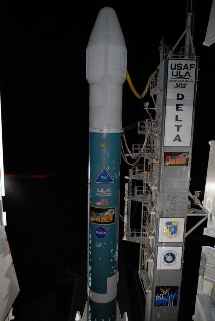 KENNEDY SPACE CENTER, FLA. -- The Delta II rocket stands ready for launch following rollback of the mobile service tower, or gantry, on Launch Pad 17B at Cape Canaveral Air Force Station.  Starting with a boost from this higher thrust version of the Delta II rocket, the Dawn spacecraft will study the asteroid Vesta and dwarf planet Ceres, celestial bodies believed to have accreted early in the history of the solar system. To carry out its scientific mission during its nearly decade-long mission, Dawn will carry a visible camera, a visible and infrared mapping spectrometer, and a gamma ray and neutron spectrometer, whose data will be used in combination to characterize these bodies. In addition to the three instruments, radiometric and optical navigation data will provide data relating to the gravity field, and thus, bulk properties and internal structure of the two bodies. Data returned from the Dawn spacecraft could provide opportunities for significant breakthroughs in our knowledge of how the solar system formed.  Launch is targeted for Sept. 27 during a window that extends from 7:20 to 7:49 a.m. EDT.   Photo credit: NASA/Kim Shiflett KSC-07pd2580