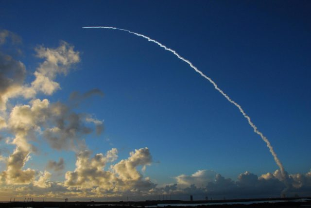 KENNEDY SPACE CENTER, FLA. -- Leaving the clouds behind, the Delta II rocket carrying the Dawn spacecraft arcs through the blue sky over the Atlantic Ocean.  Liftoff was at 7:34 a.m. EDT from Pad 17-B at Cape Canaveral Air Force Station. Dawn is the ninth mission in NASA's Discovery Program. The spacecraft will be the first to orbit two planetary bodies, asteroid Vesta and dwarf planet Ceres,  during a single mission. Vesta and Ceres lie in the asteroid belt between Mars and Jupiter. It is also NASA's first purely scientific mission powered by three solar electric ion propulsion engines. Photo credit: NASA/George Shelton KSC-07pd2586