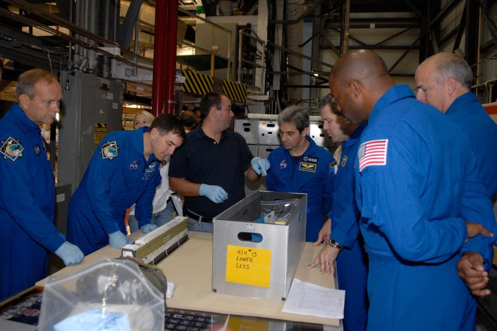 KENNEDY SPACE CENTER, FLA. -- In the Orbiter Processing Facility, STS-122 crew members are introduced to part of the LESS.  From left are Mission Specialists Hans Schlegel, Rex Walheim and European Space Agency astronaut Leopold Eyharts, Commander Stephen Frick, Mission Specialist Leland Melvin and Pilot Alan Poindexter.   The crew is at Kennedy to take part in a crew equipment interface test, or CEIT, which helps familiarize them with equipment and payloads for the mission.  Among the activities standard to a CEIT are harness training, inspection of the thermal protection system and camera operation for planned extravehicular activities, or EVAs.  STS-122 is targeted for launch in December.   Photo credit: NASA/Kim Shiflett KSC-07pd2616