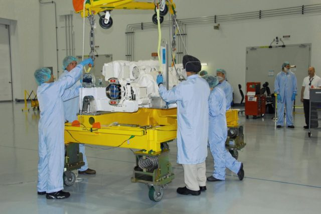 KENNEDY SPACE CENTER, FLA. -- In the Space Station Processing Facility at NASA's Kennedy Space Center, technicians adjust the cables of an overhead crane on the starboard arm of the Special Purpose Dexterous Manipulator, known as Dextre.  The arm will be moved to and installed on the base.  Dextre is a sophisticated dual-armed robot, which is part of Canada's contribution to the International Space Station ISS. Along with Canadarm2, whose technical name is the Space Station Remote Manipulator System, and a moveable work platform called the Mobile Base System, these three elements form a robotic system called the Mobile Servicing System, or MSS. The three components have been designed to work together or independently. Dextre is part of the payload scheduled on mission STS-123, targeted to launch Feb. 14.  Photo credit: NASA/George Shelton KSC-07pd2864
