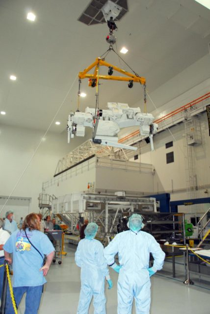 KENNEDY SPACE CENTER, FLA. -- In the Space Station Processing Facility at NASA's Kennedy Space Center, the starboard arm of the Special Purpose Dexterous Manipulator, known as Dextre, is moved across the facility. The arm will be installed on the base. Dextre is a sophisticated dual-armed robot, which is part of Canada's contribution to the International Space Station (ISS). Along with Canadarm2, whose technical name is the Space Station Remote Manipulator System, and a moveable work platform called the Mobile Base System, these three elements form a robotic system called the Mobile Servicing System, or MSS. The three components have been designed to work together or independently. Dextre is part of the payload scheduled on mission STS-123, targeted to launch Feb. 14.  Photo credit: NASA/George Shelton KSC-07pd2866