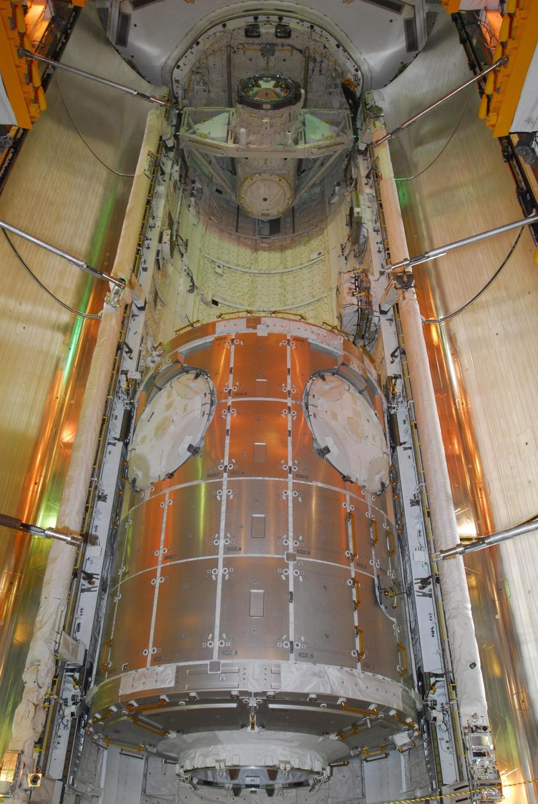 KENNEDY SPACE CENTER, FLA. -- At Launch Pad 39A, space shuttle Discovery's payload bay doors begin to close around the U.S. Node 2 module, named Harmony.  The name was chosen from an academic competition involving more than 2,200 U. S. students in kindergarten through high school. The module will be delivered to the International Space Station aboard Discovery on the 14-day STS-120 mission.  An orbiter's payload bay door closure at the pad is a milestone signaling that the launch date is near.  Discovery's launch is targeted for Oct. 23 at 11:38 a.m. EDT.  Photo credit: NASA/George Shelton KSC-07pd2821