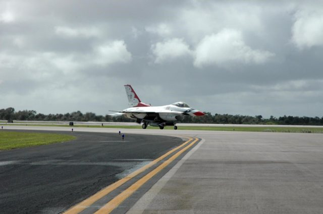 KENNEDY SPACE CENTER, FLA. -- Another of the U.S. Air Force Thunderbirds lands at the Shuttle Landing Facility at NASA's Kennedy Space Center.  The aerial demonstration squadron is performing for the World Space Expo being held from Nov. 1 to Nov. 4 at the NASA Kennedy Space Center Visitor Complex.  Other aircraft participating in the salute include U.S. Air Force F-22 Raptor, U.S. Navy F-18 Super Hornet, U.S. Air Force F-15 Eagle, the P-51 Mustang Heritage Flight and the U.S. Air Force 920th Rescue Wing, which was responsible for Mercury and Gemini capsule recovery.  The U.S. Army Golden Knights also will demonstrate precision skydiving.  The World Space Expo is an event to commemorate humanity's first 50 years in space while looking forward to returning people to the moon and exploring beyond. The expo will showcase various panels, presentations and educational programs. It also is a part of NASA's 50th anniversary celebrations, highlighting the 45th Anniversary of the Mercury Program celebration featuring original NASA astronauts John Glenn and Scott Carpenter and the Pioneering Women of Aerospace forum featuring Eileen Collins and other prominent female space veterans. The agency was founded Oct. 1, 1958.  Photo credit: NASA/Jack Pfaller KSC-07pd3049