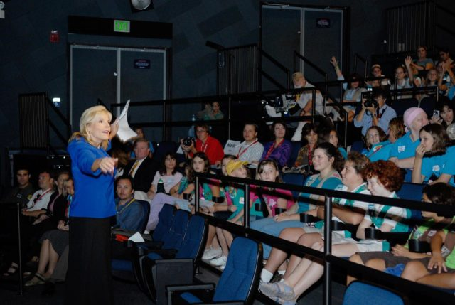 KENNEDY SPACE CENTER, FLA. --  Barbara West, from local ABC affiliate WFTV, talks to the audience of Girl Scouts attending the Pioneering Women of Aerospace forum during the World Space Expo held at NASA's Kennedy Space Center Visitor Complex.  The forum featured Eileen Collins and other prominent female space veterans. The expo commemorates humanity's first 50 years in space while looking forward to returning people to the moon and exploring beyond.  The expo showcased various panels, presentations and educational programs, as well as an aerial salute featuring the U.S. Air Force Thunderbirds, U.S. Air Force F-22 Raptor, U.S. Navy F-18 Super Hornet, U.S. Air Force F-15 Eagle, the P-51 Mustang Heritage Flight, and the U.S. Air Force 920th Rescue Wing, which was responsible for Mercury and Gemini capsule recovery. The U.S. Army Golden Knights also demonstrated precision skydiving. Photo credit: NASA/Kim Shiflett KSC-07pd3073