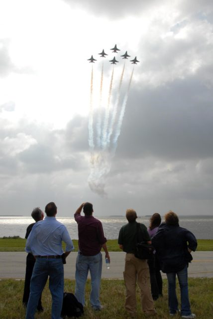KENNEDY SPACE CENTER, FLA. -- Visitors gather along the NASA Causeway to watch the U.S. Air Force Thunderbirds practicing for the World Space Expo Aerial Salute at NASA's Kennedy Space Center.  Commemorating humanity's first 50 years in space while looking forward to returning people to the moon and exploring beyond, the expo will showcase various panels, presentations and educational programs, as well as the air show.  Participating in the air show are the U.S. Air Force Thunderbirds, U.S. Air Force F-22 Raptor, U.S. Navy F-18 Super Hornet, U.S. Air Force F-15 Eagle, the P-51 Mustang Heritage Flight, and the U.S. Air Force 920th Rescue Wing, which was responsible for Mercury and Gemini capsule recovery. The U.S. Army Golden Knights will also demonstrate precision skydiving. Photo credit: NASA/George Shelton. KSC-07pd3083