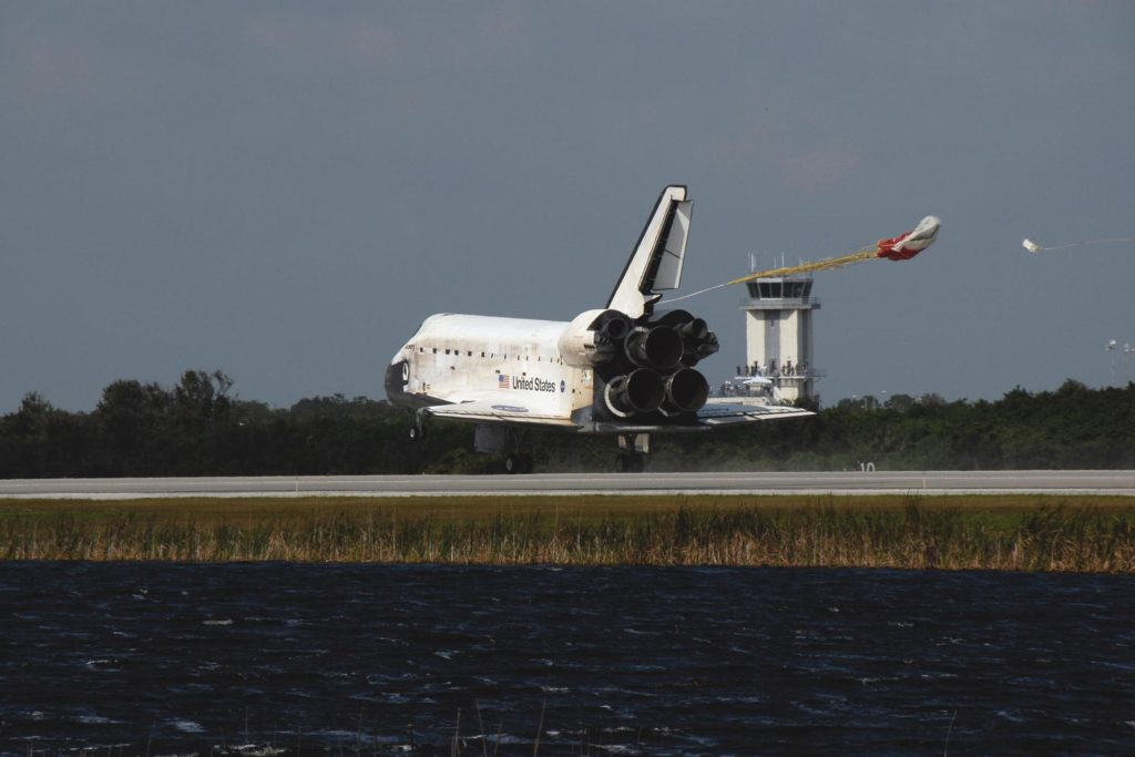 KENNEDY SPACE CENTER, FLA. -- The drag chute is deployed behind space shuttle Discovery to help slow its landing on Runway 33 of the Shuttle Landing Facility at NASA's Kennedy Space Center at 1:01 p.m. EST on Nov. 7, completing the 15-day mission STS-120.  Main gear touchdown was 1:01:16 p.m.  Wheel stop was at 1:02:07 p.m.  Mission elapsed time was 15 days, 2 hours, 24 minutes and 2 seconds. The STS-120 crew continued the construction of the station with the installation of the Harmony Node 2 module and the relocation of the P6 truss. Photo credit: NASA/Kim Shiflett KSC-07pd3157