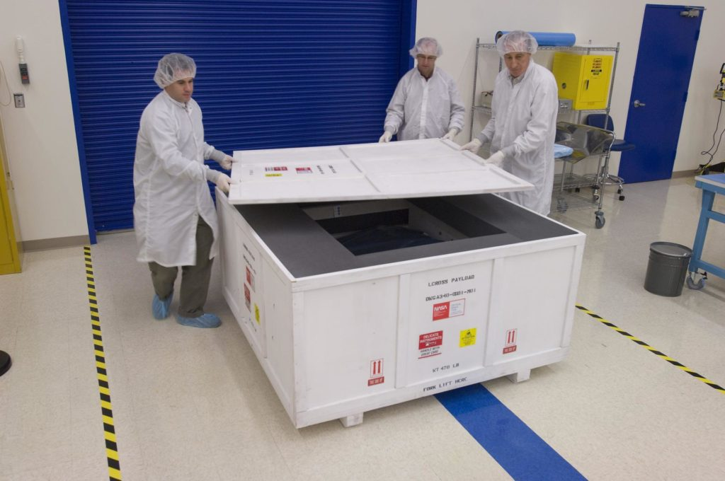 LCROSS in Ames clean room N-240- securing special made crate for transfer to Northrup Grumman Redondo Beach, CA where more calibration will be done before finally being sent for mating with the LRO spacecraft (with Tony Colaprete (l) LCROSS P.I. Steve Ord, Project Management Division (c) ) and Unknown) ARC-2008-ACD07-0073-458