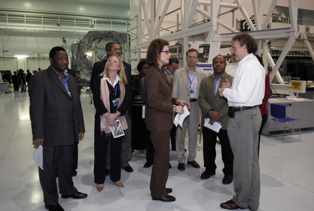KENNEDY SPACE CENTER, FLA. -- A group of The Chiefs of Diplomatic Missions from more than 45 countries tour the Space Station Processing Facility.  In the foreground, U.S. Ambassador Nancy Brinker, who is the host for the Diplomatic Corps, talks to Russell Romanella, director of the International Space Station and Payload Processing Directorate.  Ambassador Brinker is President Bush's representative and liaison to the foreign ambassadors in Washington. The visit, one of the largest tours undertaken by the diplomatic corps, is part of the State Department's new Experience America program. The international dignitaries were provided an overview of the United States' space exploration programs and NASA's international cooperation in pursuit of exploration and scientific discovery. They visited various locations at Kennedy, including the Space Station Processing Facility and Launch Pad 39A where space shuttle Atlantis is being prepared for its upcoming mission to the International Space Station.   Photo credit: NASA/Kim Shiflett KSC-08pd0096