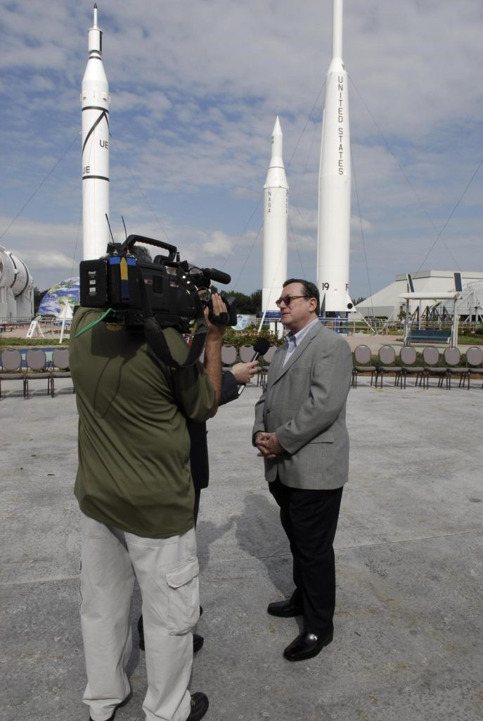 KENNEDY SPACE CENTER, FLA. -- In the rocket garden at NASA's Kennedy Space Center Visitor Complex, Gilles Noghes, ambassador of Monaco, is interviewed.  Noghes is one of The Chiefs of Diplomatic Missions from more than 45 countries who toured various facilities around Kennedy. The visit, one of the largest tours undertaken by the diplomatic corps, is part of the State Department's new Experience America program. The international dignitaries were provided an overview of the United States' space exploration programs and NASA's international cooperation in pursuit of exploration and scientific discovery. They visited various locations at Kennedy, including the Space Station Processing Facility and Launch Pad 39A where space shuttle Atlantis is being prepared for its upcoming mission to the International Space Station.   Photo credit: NASA/Kim Shiflett KSC-08pd0099