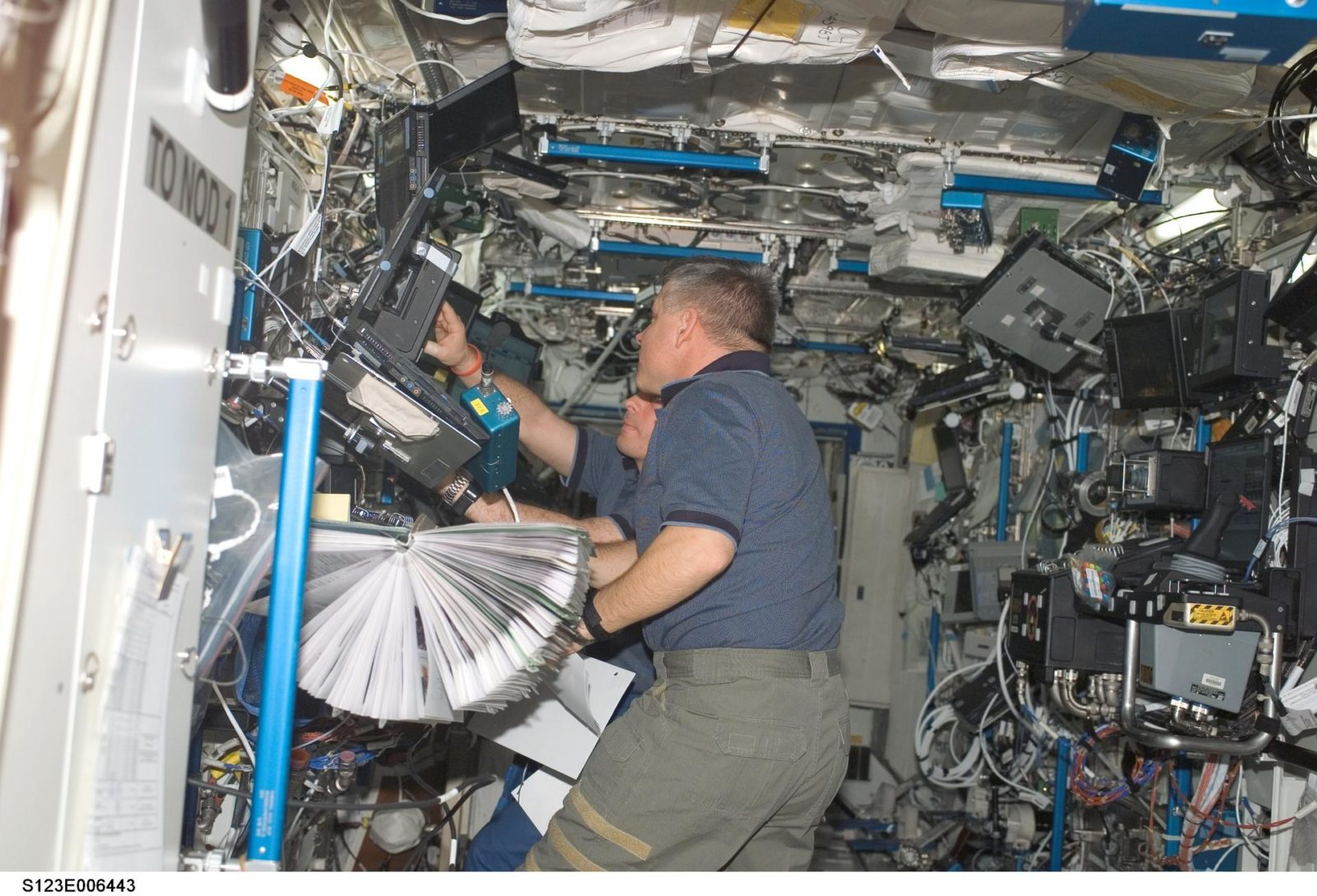Johnson works the controls of Robotic Canadarm2 in the U.S. Laboratory during Joint Operations