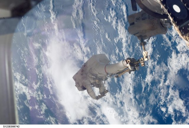Linnehan anchored to a Canadarrm2 mobile foot restraint during Expedition 16 / STS-123 Joint Operations