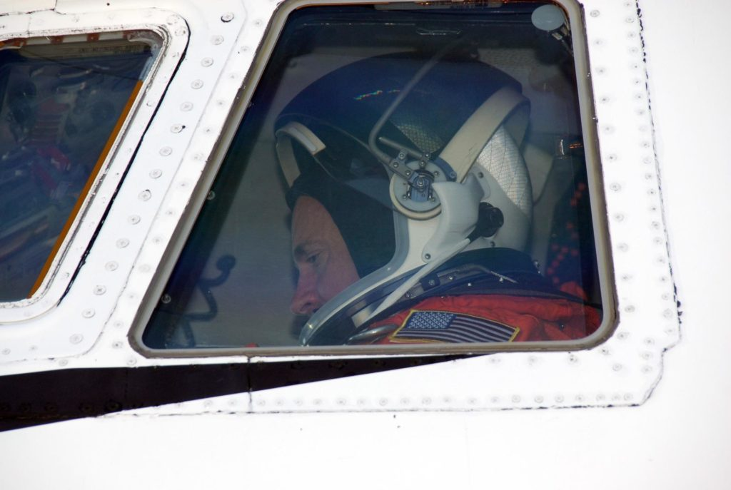 CAPE CANAVERAL, Fla. --   On the Shuttle Landing Facility at NASA's Kennedy Space Center, the commander of the STS-124 mission, Mark Kelly, sits in the cockpit of the shuttle training aircraft, or STA.  He is getting ready to practice landing the shuttle on the SLF runway.   The STA is a Grumman American Aviation-built Gulf Stream II jet that was modified to simulate an orbiter's cockpit, motion and visual cues, and handling qualities. In flight, the aircraft duplicates the orbiter's atmospheric descent trajectory from approximately 35,000 feet altitude to landing on a runway.  Space shuttle Discovery is scheduled to lift off on the STS-124 mission at 5:02 p.m. May 31. Photo credit:  NASA/Kim Shiflett KSC-08pd1468