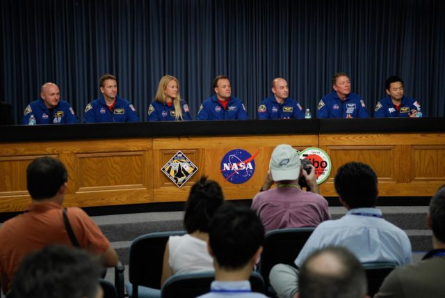 CAPE CANAVERAL, Fla.  –  Following the successful landing of space shuttle Discovery at NASA's Kennedy Space Center to end the 14-day, STS-124 mission, the crew sits for a press conference.  Seated left to right are Commander Mark Kelly, Pilot Ken Ham, and Mission Specialists Karen Nyberg, Ron Garan, Garrett Reisman, Mike Fossum and Akihiko Hoshide.  Reisman returned to Earth on Discovery after a 95-day stay on the International Space Station. The STS-124 mission delivered the Japan Aerospace Exploration Agency's large Japanese Pressurized Module and its remote manipulator system to the International Space Station. The landing was on time at 11:15 a.m. EDT.  Photo credit: NASA/Kim Shiflett KSC-08pd1749