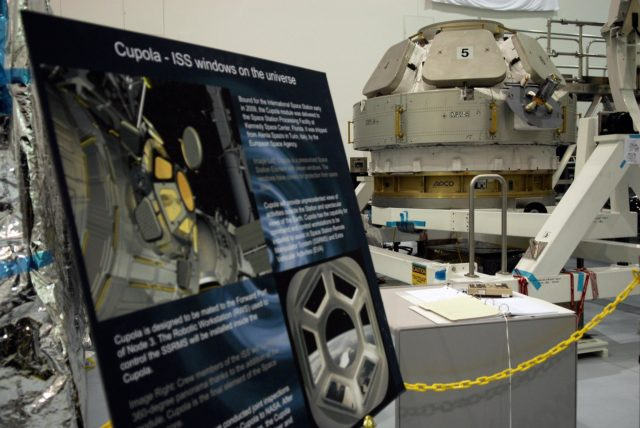 CAPE CANAVERAL, Fla.  –  The Cupola, another module built in Italy for the United States segment of the International Space Station, resides in the Space Station Processing Facility. With 360-degree windows, it will serve as a literal skylight to control some of the most sophisticated robotics ever built. The space station crew will use Cupola windows, six around the sides and one on the top, for line-of-sight monitoring of outside activities, including spacewalks, docking operations and exterior equipment surveys. The Cupola will be used specifically to monitor the approach and berthing of the Japanese H-2 supply spacecraft and other visiting vehicles. The Cupola also will serve as the primary location for controlling Canadarm2, the 60-foot space station robotic arm. Space station crews currently use two robotic control workstations in the Destiny laboratory to operate the arm. One of the robotic control stations will be placed inside the Cupola. The view from the Cupola will enhance an arm operator's situational awareness, supplementing television cameras and graphics. The Cupola is scheduled to launch on a future space station assembly mission. It will be installed on the forward port of Node 3, a connecting module to be installed as well.  Photo credit: NASA/Kim Shiflett KSC-08pd1795