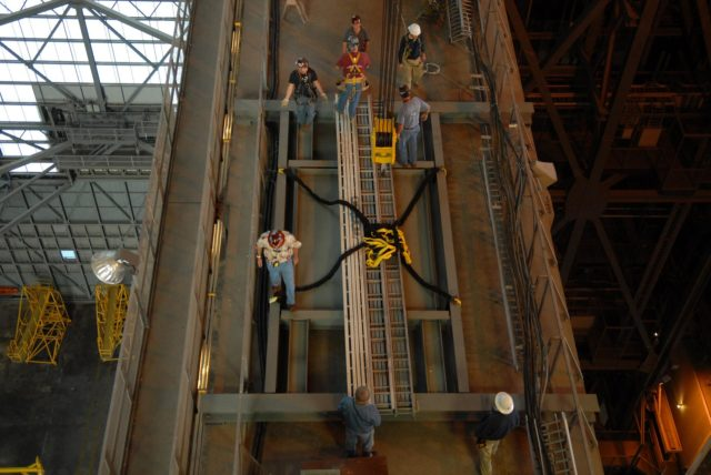 CAPE CANAVERAL, Fla. –In the Vehicle Assembly Building's high bay 3 at NASA's Kennedy Space Center in Florida, framework is lifted to the 16th floor for modifications related to the Ares I-X. The refurbishment of the facility is for the Constellation Program's Ares vehicles. The Ares I and Ares V rockets will be 325 feet and 360 feet tall, respectively, considerably taller than the space shuttle atop its mobile launcher platform.    Photo credit: NASA/Troy Cryder KSC-2009-1398