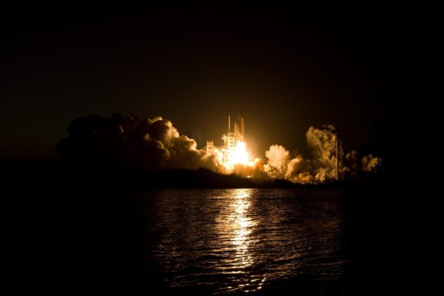 CAPE CANAVERAL, Fla. – Billows of smoke and the water near Launch Pad 39A at NASA's Kennedy Space Center in Florida capture the brilliant light of space shuttle Discovery's lift-off on the STS-119 mission.  The launch was on time at 7:43 p.m. EDT. The STS-119 mission is the 28th to the International Space Station and the 125th space shuttle flight.  Discovery will deliver the final pair of power-generating solar array wings and the S6 truss segment.  Installation of S6 will signal the station's readiness to house a six-member crew for conducting increased science. Photo credit: NASA/Sandra Joseph, Kevin O'Connell KSC-2009-2071