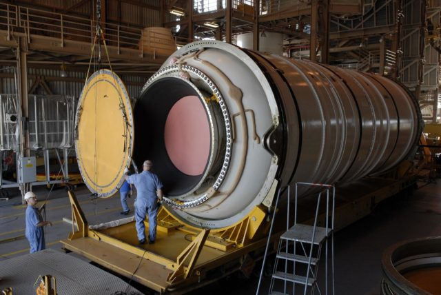 CAPE CANAVERAL, Fla. –In the Rotation, Processing and Surge Facility at NASA's Kennedy Space Center in Florida, the end of the Ares I-X motor segment is removed to allow propellant grain inspection of the interior.  It is one of four reusable motor segments and nozzle exit cone shipped by the Ares I first-stage prime contractor Alliant Techsystems Inc. for final processing and integration in the facility. The booster used for the Ares I-X launch is being modified by adding new forward structures and a fifth segment simulator. The motor is the final hardware needed for the rocket's upcoming flight test this summer. The stacking operations are scheduled to begin in the Vehicle Assembly Building in April. Photo credit: NASA/Jim Grossmann KSC-2009-2318