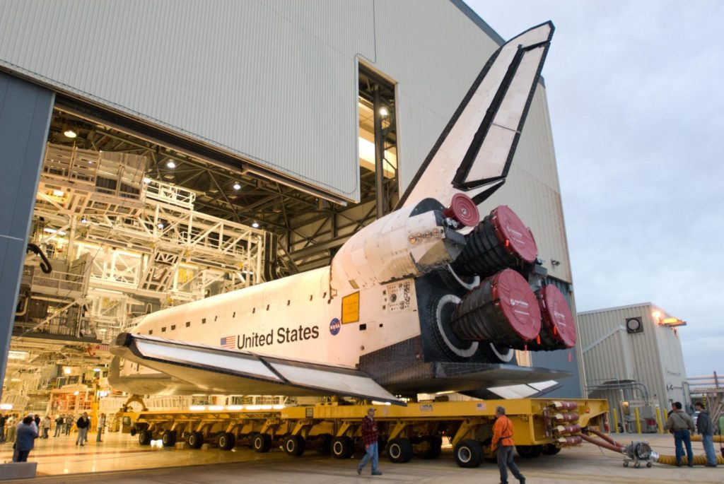 CAPE CANAVERAL, Fla. –  Space shuttle Endeavour begins its move from Orbiter Processing Facility 2 to the Vehicle Assembly Building at NASA's Kennedy Space Center, Fla. The first motion of the shuttle out of its hangar was at 6:56 a.m. EDT. In the VAB, Endeavour will be lifted into High Bay 1 and mated to the external fuel tank and solid rocket boosters already installed on the mobile launcher platform. Endeavour is scheduled to roll out to Launch Pad 39B in about a week.  Endeavour will be prepared on the pad for liftoff in the unlikely event that a rescue mission is necessary following space shuttle Atlantis' launch on the STS-125 mission to service the Hubble Space Telescope. After Atlantis is cleared to land, Endeavour will move to Launch Pad 39A for its upcoming STS-127 mission to the International Space Station, targeted to launch in mid-June.   Photo credit: NASA/Jim Grossmann KSC-2009-2569